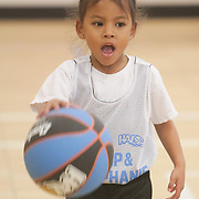 Aaliyah Jeralds dribbles during Halo Basketball Saturday December 20, 2014 at Grace United Methodist Church in Wilmington, N.C. (Jason A. Frizzelle)