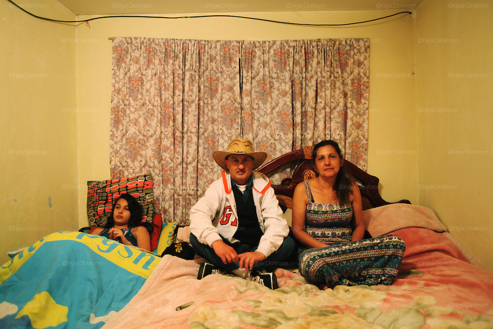 Roma family on their bed. Bogota, Columbia<br /> <br /> Roma came to the Americas as early as Christopher Columbus's first voyage. Roma were exported and sold as slaves along with negroes from Africa. Europe tried to solve its 'roma problem' by deporting many Roma slaves to the americas. In the 1920s Roma, Chinese and mentally handicapped were not allowed to enter the USA anymore. After that Roma went to South America and the Carribean with a view to traveling north across borders, but many ended up by setting up communities in the southern hemisphere. Nowadays about two million Roma live between North and South America.