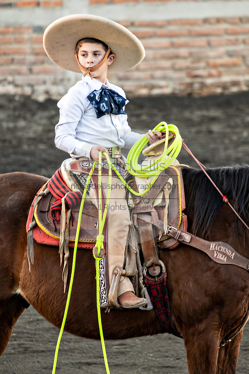 Luis Alfonso Franco, Jr. during a family Charreria practice session in the Jalisco Highlands town of Capilla de Guadalupe, Mexico. The Franco family has dominated Mexican rodeo for 40-years and has won three national championships, five second places and five third places.