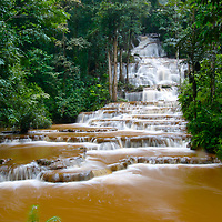 The chocolate colored waters of Namtok Pha Charoen during the rainy season. The waterfall is situated in Tak province in Thailand