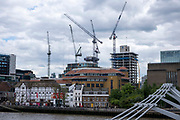 Construction cranes on London's skyline above Shakespeare's Globe theatre on the 25th of May 2021 in London, United Kingdom.