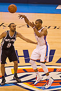 June 2, 2012; Oklahoma City, OK, USA; Oklahoma City Thunder guard Russell Westbrook (0) makes a pass over San Antonio Spurs guard Tony Parker (9) during a playoff game  at Chesapeake Energy Arena.  Thunder defeated the Spurs 109-103 Mandatory Credit: Beth Hall-US PRESSWIRE