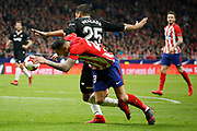 Atletico Madrid's Spanish forward Victor Vitolo is tackled during the Spanish Cup, Copa del Rey quarter final, 1st leg football match between Atletico Madrid and Sevilla FC on January 17, 2018 at Wanda Metropolitano stadium in Madrid, Spain - Photo Benjamin Cremel / ProSportsImages / DPPI