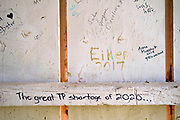 """14 SEPTEMBER 2020 - WINTERSET, IOWA: Graffiti in the Imes Bridge. The Imes Bridge, in Madison County was built in 1870. The covered bridges of Madison County are an enduring tourist attraction more than 25 years after the book and movie """"The Bridges of Madison County"""" made them famous. There are six covered bridges in Madison County, all built in the 1800s. They are remnants of about 100 covered bridges built in Iowa from the 1850s through the late 1800s. Most of the briges were washed away in floods, condemned, or destroyed in fires. The Madison County bridges have been restored and rebuilt through the years.   PHOTO BY JACK KURTZ"""
