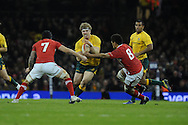 David Pocock of Australia charges into Sam Warburton (l) and Toby Faletau ® of Wales. Dove Men, autumn international test, Wales v Australia at the Millennium Stadium in Cardiff on Sat 1st Dec 2012. pic by Andrew Orchard, Andrew Orchard sports photography,