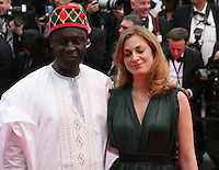 Moussa Toure and Maria Bonnevie at the the Grace of Monaco gala screening and opening ceremony red carpet at the 67th Cannes Film Festival France. Wednesday 14th May 2014 in Cannes Film Festival, France.