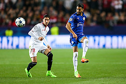 Riyad Mahrez of Leicester City is challenged by Sergio Escudero of Sevilla - Rogan Thomson/JMP - 22/02/2017 - FOOTBALL - Estadio Ramon Sanchez Pizjuan - Seville, Spain - Sevilla FC v Leicester City - UEFA Champions League Round of 16, 1st Leg.