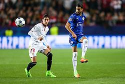 Riyad Mahrez of Leicester City is challenged by Sergio Escudero of Sevilla - Rogan Thomson/JMP - 22/02/2017 - FOOTBALL - Estadio Ramon Sanchez Pizjuan - Seville, Spain - Sevilla FC v Leicester City - UEFA Champions League Round of 16, 1st Leg.