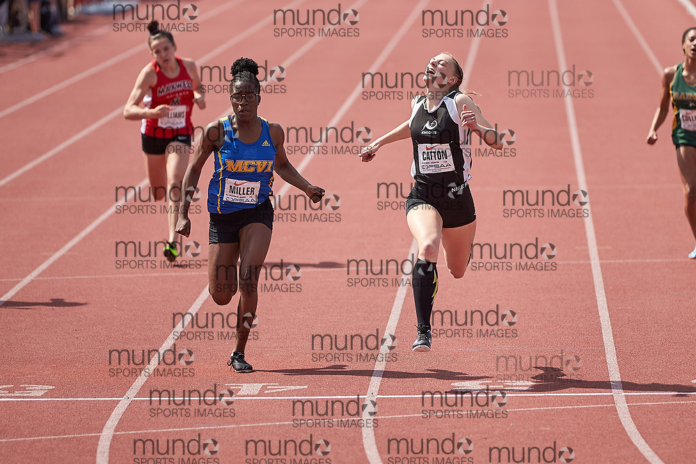 Jillian Catton of Notre Dame and  Trinity Miller of Rsmcvi  battle to the line in the junior girls 200m at the OFSAA Track and Field Championships in Guelph Ontario on Saturday, June 8, 2019.<br /> Mundo Sport Images/ Geoff Robins