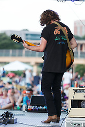 """Music band at the """"Rockin' the River"""" festivities  at the Panther Island Pavilion, Trinity River, Fort Worth, Texas, USA."""