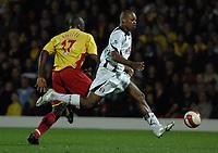 Photo: Richard Lane.<br />Watford v Fulham. The Barclays Premiership. 02/10/2006. <br />Fulham's Collins John breaks away from Dan Shittu.