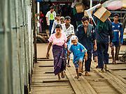 03 NOVEMBER 2015 - YANGON, MYANMAR: A woman and her son walk to a ferry on the Yangon docks.    PHOTO BY JACK KURTZ