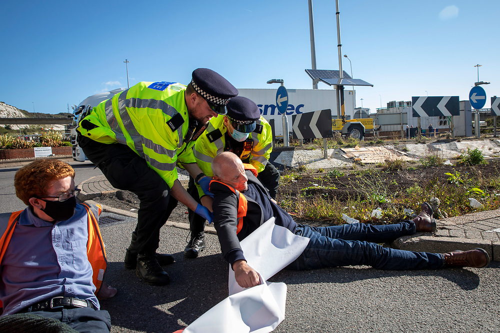 Police start to remove activist from Insulate Britain who have blockaded the entrance to the port of Dover on the 24th of September 2021. Over 40 activists from Insulate Britain blocked the road with some gluing themselves to the carriageway of the A20 at the Eastern docks roundabout. There are blocking the roads to highlight that fuel poverty is killing people in Dover and across the UK. (photo by Andrew Aitchison / In pictures via Getty Images)