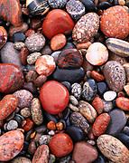 Colorful wave-washed Lake Superior stones at Crisp Point, Upper Peninsula of Michigan.