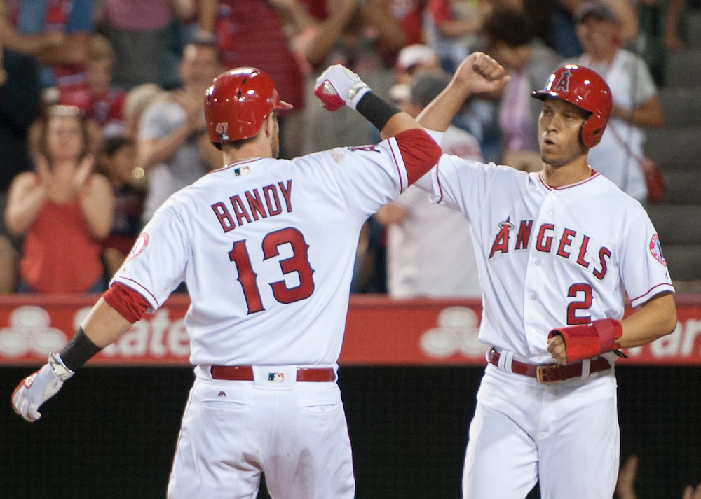 The Angels' Jett Bandy celebrates with Andrelton Simmons after his two-run home in the fifth inning against the Oakland Athletics at Angel Stadium on Tuesday.<br /> <br /> ///ADDITIONAL INFO:   <br /> <br /> angels.0803.kjs  ---  Photo by KEVIN SULLIVAN / Orange County Register  -- 8/2/16<br /> <br /> The Los Angeles Angels take on the Oakland Athletics at Angel Stadium.
