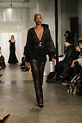 """NEW YORK, NEW YORK-FEBRUARY 13: A Model walks the runway """"CAPTURED"""" the Fall/Winter Collection 2019 presented by Designer Aisha McShaw during New York Fashion Week and held at the Gallery at Prince George Ballroom on February 11, 2019 in New York City.  (Photo by Terrence Jennings/terrencejennings.com)"""