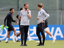 England manager Gareth Southgate (left) and striker coach Allan Russell during the training session at the Spartak Zelenogorsk Stadium, Repino.