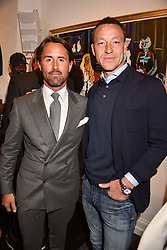 Left to right, Jay Rutland and John Terry at a private view of work by Bradley Theodore entitled 'The Second Coming' at the Maddox Gallery, 9 Maddox Street, London England. 19 April 2017.