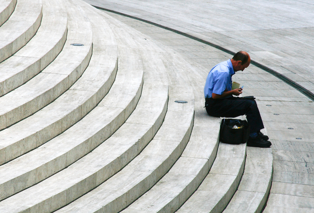 City worker taking a break in Broadgate Circus, City of London