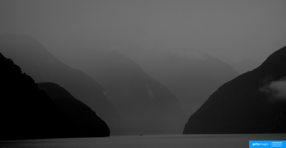 Doubtful Sound, South Island, New Zealand...You would be forgiven for thinking you'd just stepped out of a time machine while travelling around the South Island of New Zealand.. From the misty shades of grey in the fiord of Doubtful Sound, to the fully operational Steamboat the TSS Earnslaw; the Lady of the Lake on Lake Wakitepo, this beautiful island is a Tardis for tourists!..The South Island of New Zealand is roughly the size of England, but it's population of less than a million people means much of the land remains free from human development. It's breathtaking views, and it's climate, could be likened to a cross between Scotland and Scandinavia, and around every corner is mostly unspoilt natural beauty....The Commercialised resort town of Queenstown is the nerve centre of the islands tourism industry, providing the more adventurous thrill seeker with jet boating, skydiving, bungy jumping, and paragliding to name just a few of the more adventurous activities..Queenstown also provides numerous Lord of the Rings tours into middle earth.. In stark contrast the TSS Earnslaw, The Vintage Steamship which has graced the waters of Lake Wakatipu since 1912 provides daily voyages to Walters Peak and a step back in time for it's passengers. The voyage even includes a good old fashion sing-a-long to songs of yesteryear...Just forty five minutes out of Queenstown the Kingston Flyer, a vintage steam train still operates on 14km of track using two AB Pacific Class steam locomotives built in 1925 and 1927 respectively, although the Flyer's history began much earlier in 1878 when it operated between the main south line and Gore..Fijordland on the south Western side of the Island has some of the world's greatest treks; indeed the Milford Track is often booked up way in advance...