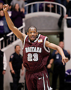Montana's Anthony Johnson reacts as the final second ticks off the clock in the Grizzlies upset win over Weber State in the NCAA, Big Sky Conference championship basketball game, Wednesday, March 10, 2010 in Ogden, Utah. Johnson scored a tournament record, 42 points. (AP Photo/Colin E Braley)