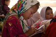 Balkh province Afghanistan. Samarkand-Dion. Children's centre, extra education. Girl writing in an exercise book.
