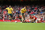 Leigh Halfpenny of Wales falls to claim a loose ball. Under Armour 2016 series international rugby, Wales v Australia at the Principality Stadium in Cardiff , South Wales on Saturday 5th November 2016. pic by Andrew Orchard, Andrew Orchard sports photography