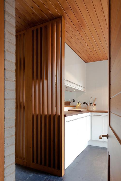 1960s modern kitchen interior with wooden divide