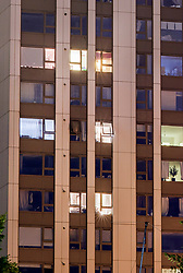 © Licensed to London News Pictures. 25/06/2017. London, UK. Lights on in widows of the Taplow block on the Chalcots estate in Swiss Cottage, Camden, showing residents who have refused to leave in the early ours of the morning on June 25th. Residents have been asked to leave their apartments on the north london estate after government tests found cladding on the building were flammable, making the buildings unsafe. Photo credit: Andre Camara/LNP