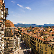 A view of the Duomo (Basilica of Saint Mary of the Flower ) and the city of Florence , Italy, from the Giotto's bell tower (Giotto's Campanile).