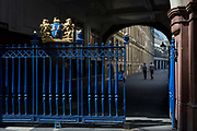 The entrance gates of Drapers Hall livery company in Throgmorton Street, on 17th Juy 2017, in the City of London, England. The Drapers' Company is a Livery Company in the City of London whose roots go back to the 13th century, when as its name indicates, it was involved in the drapery trade. While it is no longer involved in the trade, the Company has evolved acquiring a new relevance. Its main role today is to be the trustee of the charitable trusts that have been left in its care over the centuries. The Company also manages a thriving hospitality business. The first Drapers' Hall was built in the 15th century in St Swithin's Lane.  It bought a Hall on the present site in Throgmorton Street in 1543 from King Henry VIII for £1,200 about £350,000 in today's money. The Hall that the Company purchased from King Henry VIII in 1543 had been the private residence of Thomas Cromwell, Earl of Essex until his execution in 1540, when it was confiscated by the Crown.