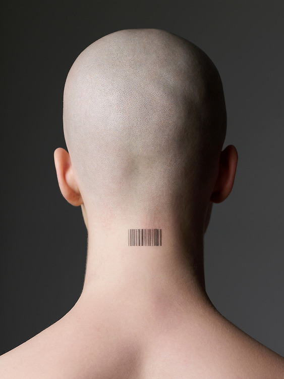 Close up of back of woman's shaved head with barcode tattooed on her neck
