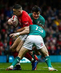 Josh Adams of Wales under pressure from Garry Ringrose of Ireland<br /> <br /> Photographer Simon King/Replay Images<br /> <br /> Six Nations Round 5 - Wales v Ireland - Saturday 16th March 2019 - Principality Stadium - Cardiff<br /> <br /> World Copyright © Replay Images . All rights reserved. info@replayimages.co.uk - http://replayimages.co.uk