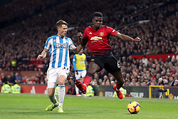 Manchester United's Paul Pogba and Huddersfield Town's Erik Durm (left)