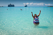 A woman from Las Vegas who, until this cruise, had never been to or in the ocean, cheers after getting the courage up to get in the water. This was a shore excursion to an island the cruise line owns.