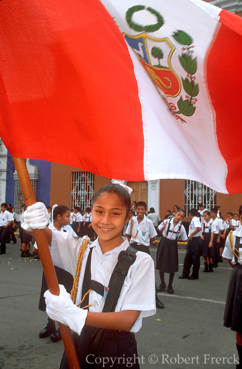 PERU, TRUJILLO, FESTIVALS Tribute to Flag; girl holding flag