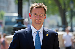 © London News Pictures. 22/05/2011. London, UK. Secretary of State for Culture, Olympics, Media and Sport Jeremy Hunt MP on Whitehall on May 22, 2012 following a cabinet meeting. It was announced yesterday (Monday) that JEREMY HUNT will face a Parliamentary inquiry into claims he failed to register corporate hospitality. Photo credit: Ben Cawthra/LNP