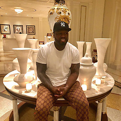 """50 Cent releases a photo on Instagram with the following caption: """"\ud83d\ude06 the man in the lobby told me please get down they are hand made. I said Yeah ok, right after I take the picture. LOL #lecheminduroi #bellator"""". Photo Credit: Instagram *** No USA Distribution *** For Editorial Use Only *** Not to be Published in Books or Photo Books ***  Please note: Fees charged by the agency are for the agency's services only, and do not, nor are they intended to, convey to the user any ownership of Copyright or License in the material. The agency does not claim any ownership including but not limited to Copyright or License in the attached material. By publishing this material you expressly agree to indemnify and to hold the agency and its directors, shareholders and employees harmless from any loss, claims, damages, demands, expenses (including legal fees), or any causes of action or allegation against the agency arising out of or connected in any way with publication of the material."""
