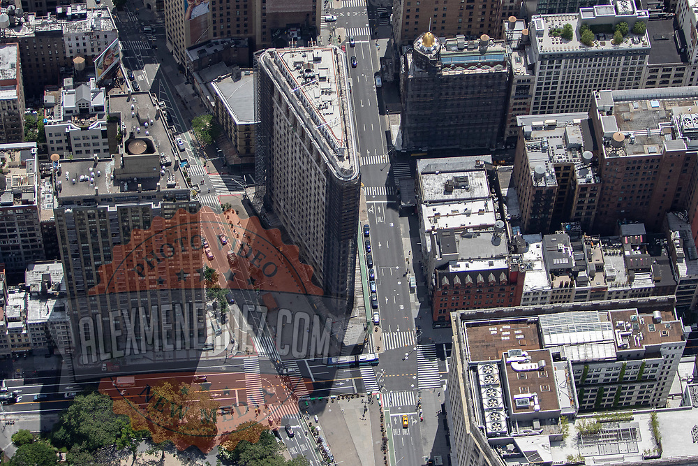 Aerial footage shows the Flat Iron Building that looks virtually empty with closed businesses and limited traffic due to the Coronavirus (Covid-19) outbreak along with the continuing protests due to the police killing of George Floyd on Monday, June 1, 2020 in New York City.  Nonessential businesses have been closed and large gatherings have been banned across the state since March 22 under an emergency order issued by Governor Cuomo and an 11 p.m. curfew was ordered by NY Mayor Bill de Blasio amid the Floyd protests. (Alex Menendez via AP)