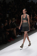 A tone-on-tone dress with cut out midriff by Richard Chai at the Spring 2013 Mercedes Benz Fashion Week show in New York.