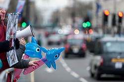 © Licensed to London News Pictures. 18/03/2016. London, UK. Demonstrators gather outside the Japanese Embassy on Piccadilly to protest against the killing of dolphins in Taiji, Japan as well as the cruelty to keeping such mammals in captivity.  This protest comes a day after SeaWorld in the USA announced that it is ending its orca breeding programme. Photo credit : Stephen Chung/LNP