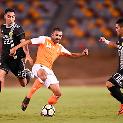 BRISBANE, AUSTRALIA - JANUARY 23: Fahid Ben Khalfallah of the Roar and Omid David Nazari of Ceres Negros compete for the ball during the AFC Champions League Second Preliminary Round match between Brisbane Roar and Ceres Negros FC on January 23, 2017 in Brisbane, Australia. (Photo by Patrick Kearney)