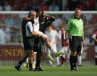 Photo: Lee Earle. <br /> Northampton Town v Swindon Town. Coca Cola Championship. 11/08/2007. <br /> Swindon's Sofian Zaaboub is carried off the pitch after getting injured.