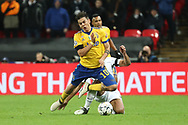 Mousa Dembele of Tottenham Hotspur (19) fouling Juventus attacker Paulo Dybala (10) and receiving yellow card during the Champions League match between Tottenham Hotspur and Juventus FC at Wembley Stadium, London, England on 7 March 2018. Picture by Matthew Redman.