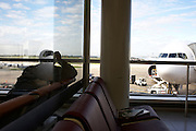 A passenger looks bored awaiting the departure of his flight from the old French capital's Orly International Airport at Orly.