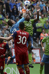 May 26, 2018 - Seattle, Washington, U.S - MLS Soccer 2018: RSL goalie NICK RIMANDO (18) punches the ball away from the Sounders KELVIN LEERDAM (18) as MARCELO SILVA (30) of RSL looks on.  Real Salt Lake visited the Seattle Sounders in a MLS match at Century Link Field in Seattle, WA. RSL won the match 1-0. (Credit Image: © Jeff Halstead via ZUMA Wire)