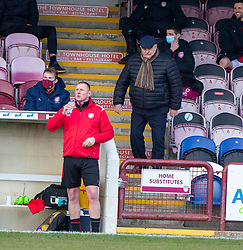 06MAR21 Arbroath's manager Dick Campbell hands to the dugout after Queen of the South scored their second goal. Arbroath 2 v 4 Queen of the South, Scottish Championship played 6/3/2021 at Arbroath's home ground, Gayfield Park.