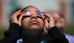 August 21, 2017 - Boynton Beach, Florida, U.S. - A student at Christa McAuliffe Middle School watches the eclipse with protective glasses provided by the school in Boynton Beach, Florida on August 21, 2017. (Credit Image: © Allen Eyestone/The Palm Beach Post via ZUMA Wire)