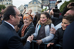 French President Francois Hollande shakes hand with members of the Armenian community during a ceremony to mark the 102nd anniversary of the Armenian genocide, in Paris, France on April 24, 2017. The anniversary is to remember the beginning of events that led to the systematic extermination of 1.5 million Armenians during World War I. Photo by Kamil Zihnioglu/Pool/ABACAPRESS.COM