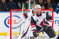 KELOWNA, BC - SEPTEMBER 29:  Derek Stepan #21 of the Arizona Coyotes looks for the pass in front of the net against the Vancouver Canucks at Prospera Place on September 29, 2018 in Kelowna, Canada. (Photo by Marissa Baecker/NHLI via Getty Images)  *** Local Caption *** Derek Stepan